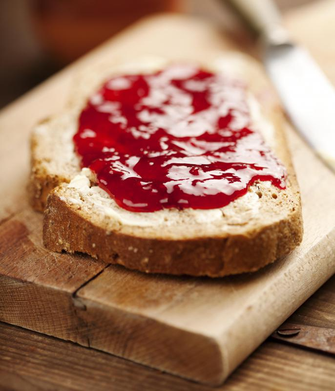 Different jams might be spread and eaten during breakfast.