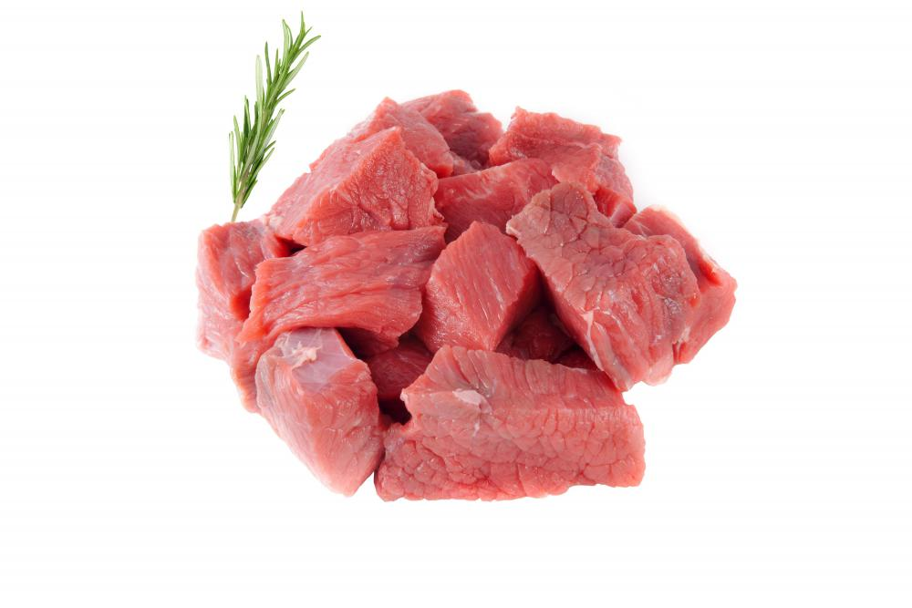 Cut up stew meat.