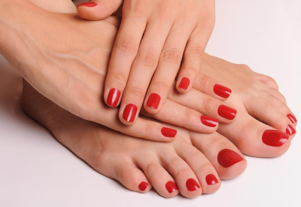 image Red nail polish foot