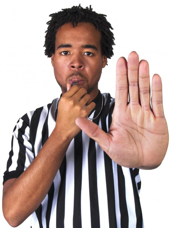 A football referee may use hand signals to indicate a ruling.