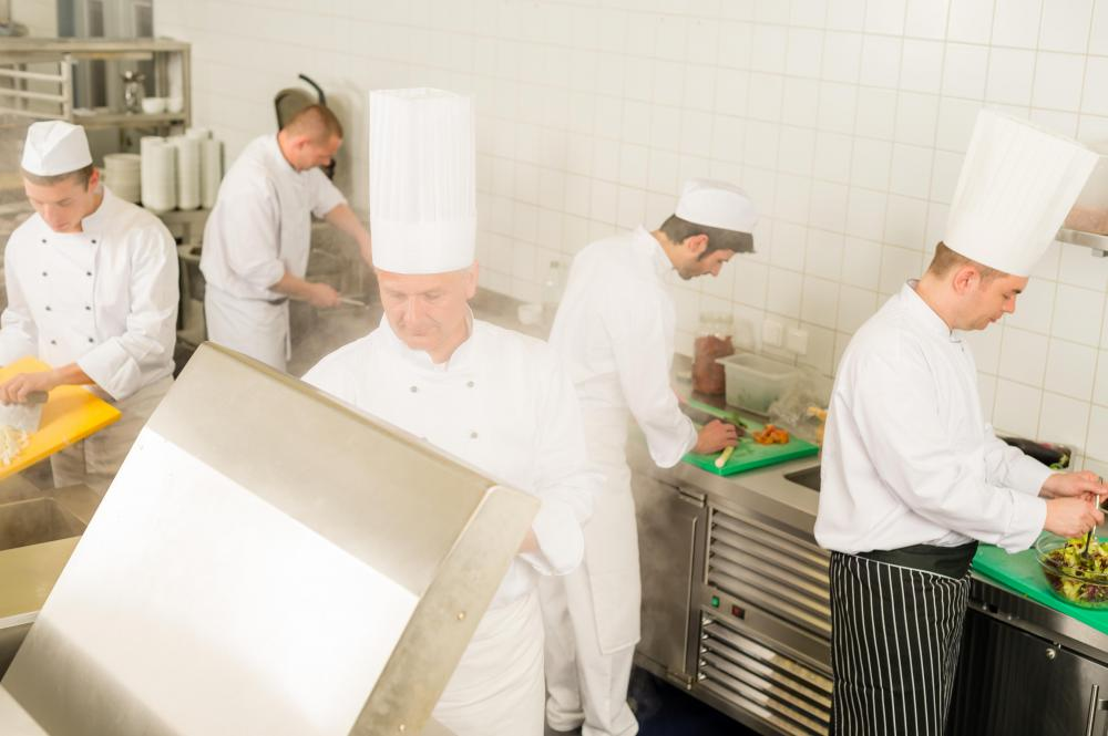 Chefs working in a restaurant kitchen.