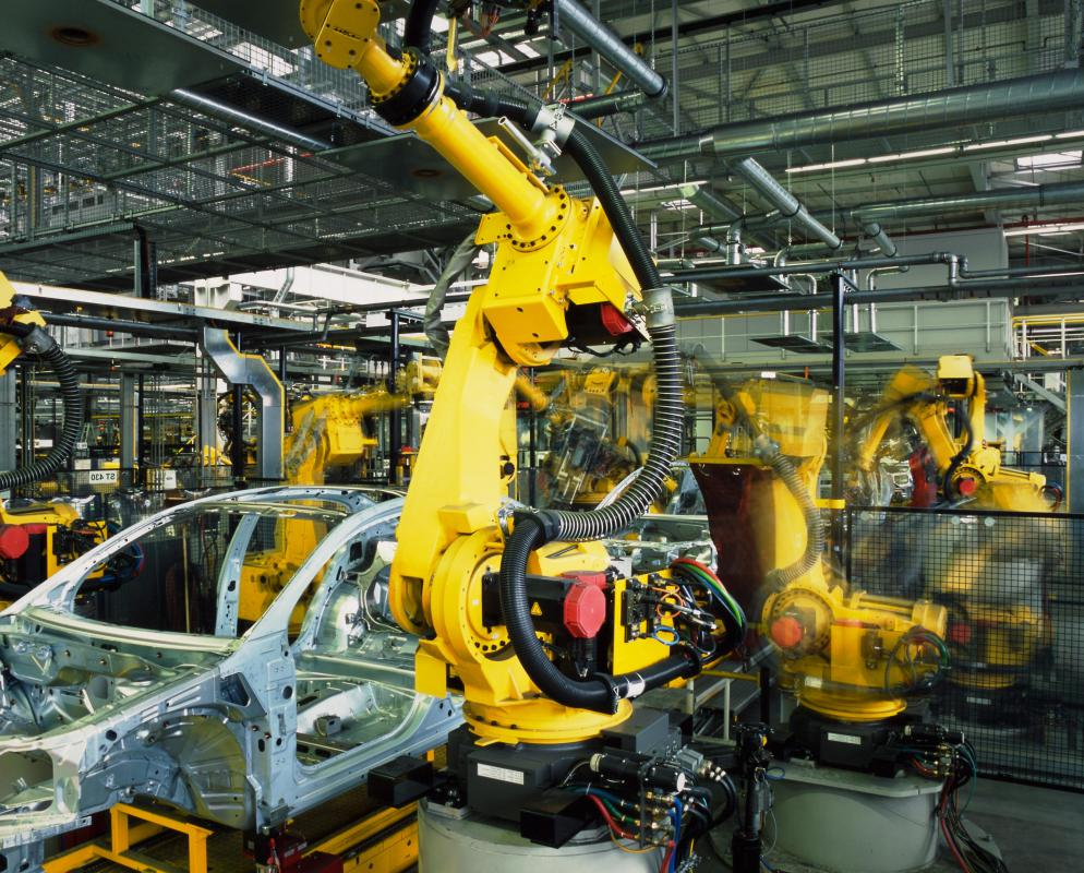 Articulated robots working on an automobile assembly line.