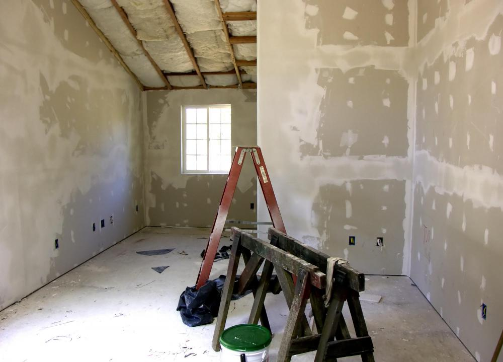 Drywall is secured to wall studs, taped where the joints meet and then sanded.