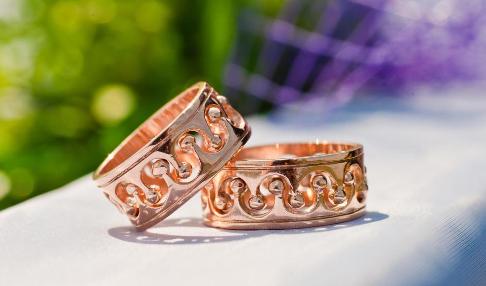 Rose gold is gold with more gold than copper, yielding a pinkish color.