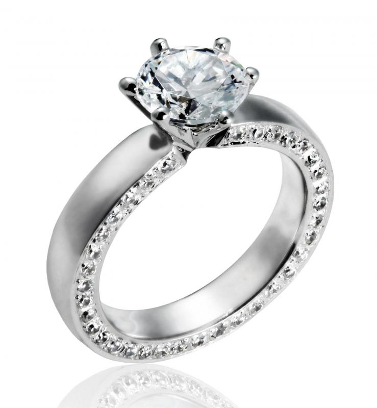 the round cut diamond is a popular choice for an engagement ring - Types Of Wedding Rings