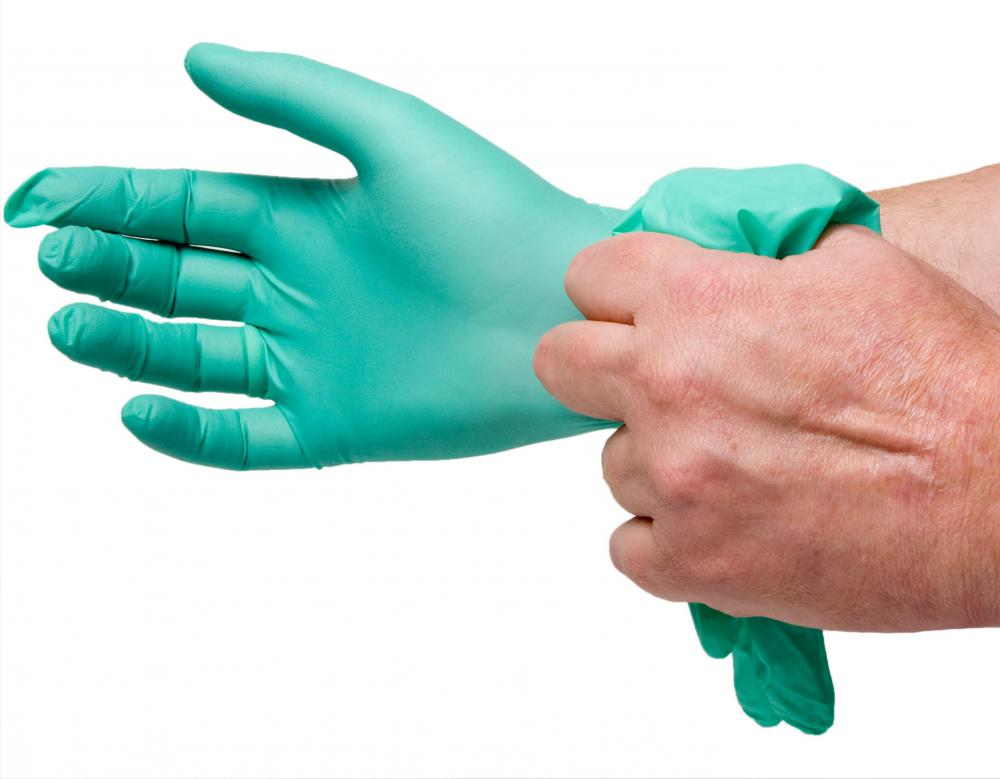 A person wearing exam gloves.