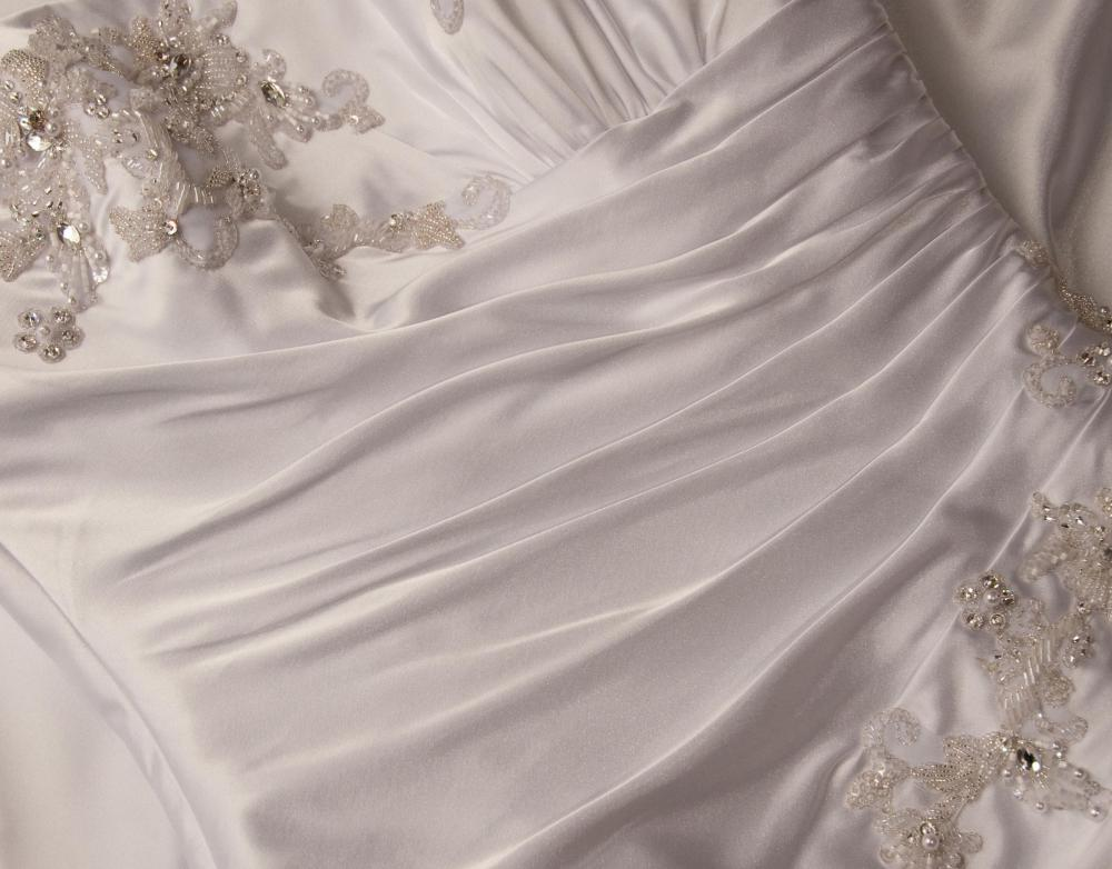 The Bride Chooses Every Type Of Material That Will Be Used In A Bespoke Wedding Dress