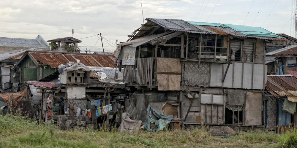 Political scientists might examine the factors which contribute to extreme poverty.