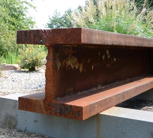 A rusty I-beam waiting to be sandblasted.
