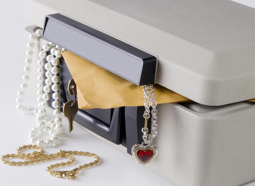 Storing important documents in a safety deposit box may help against identity theft.