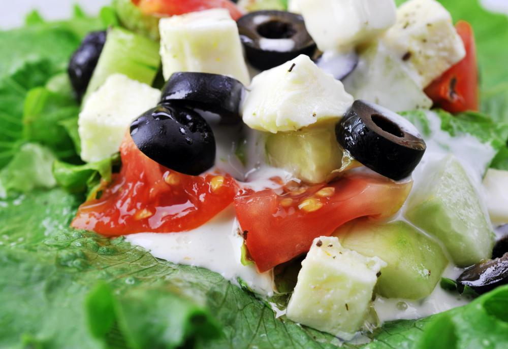 Chopped Bulgarian salad with sirene cheese, olives, and tomatoes.
