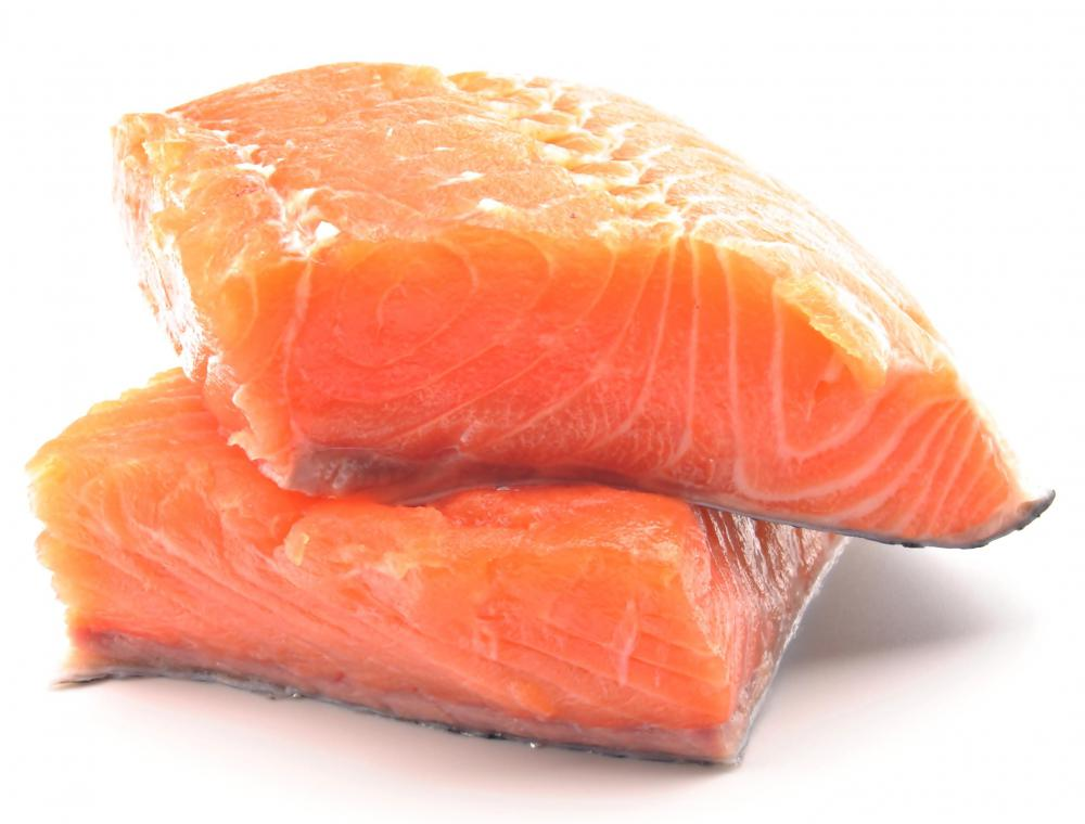 Salmon may be used as a topping on a seafood pizza.