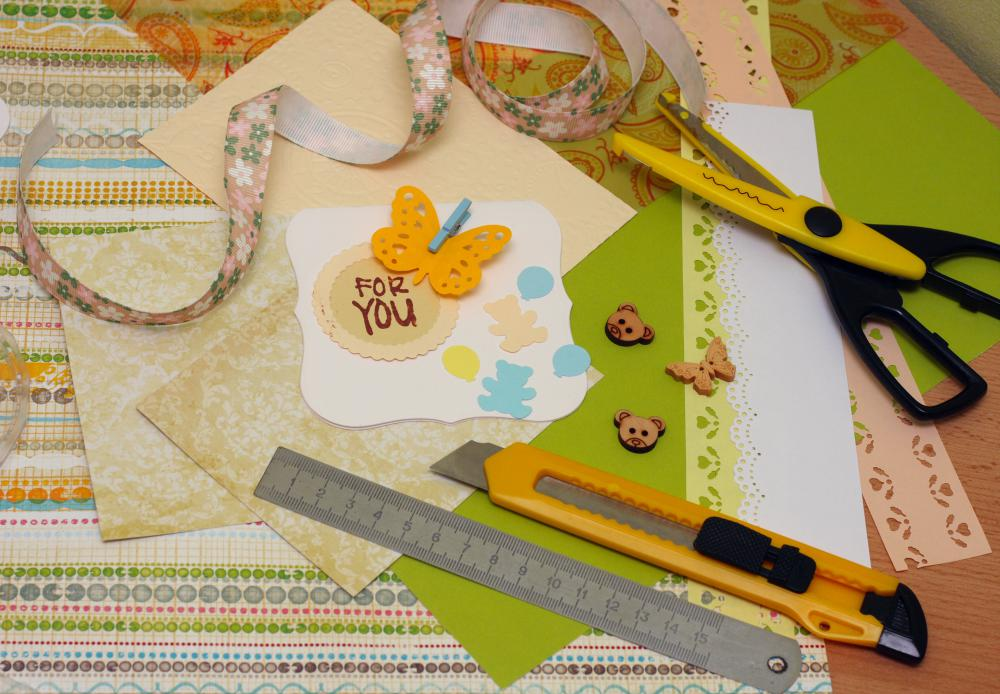 Building a supply of basic scrapbooking tools is the first step toward cheap scrapbooking.