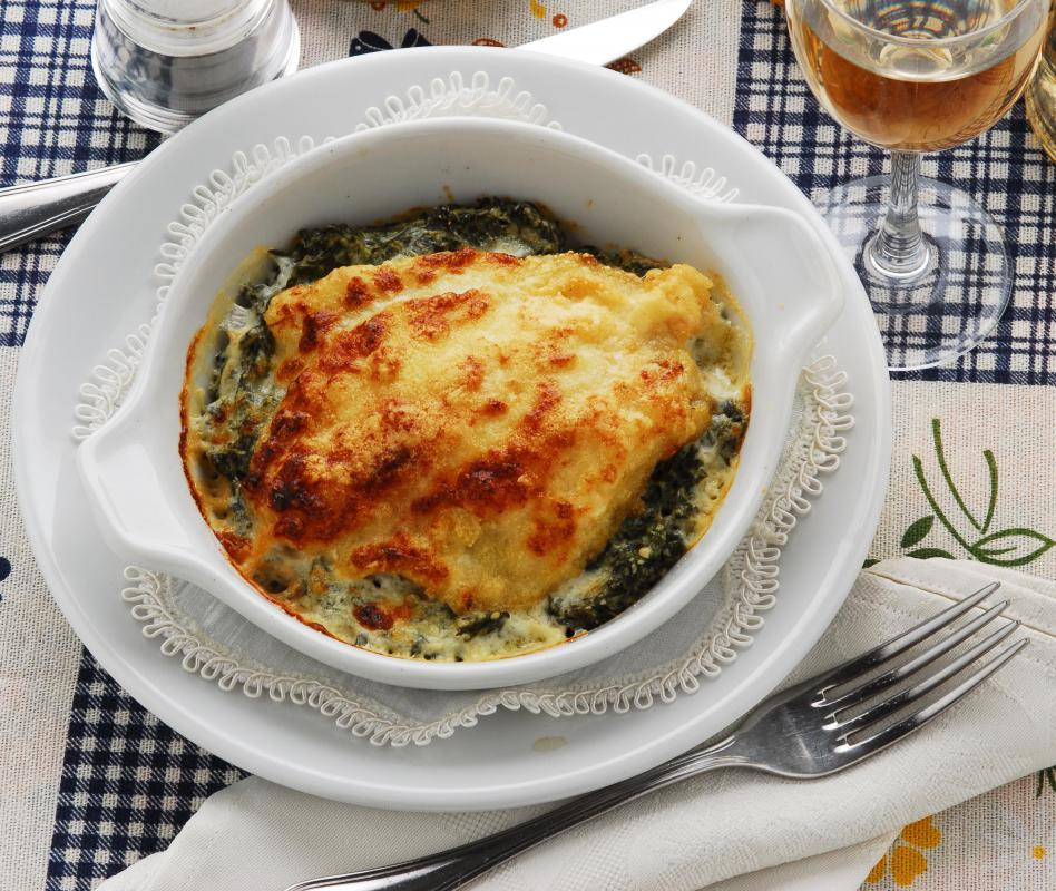 Baked fish and spinach casserole topped with a creamy cheese sauce.