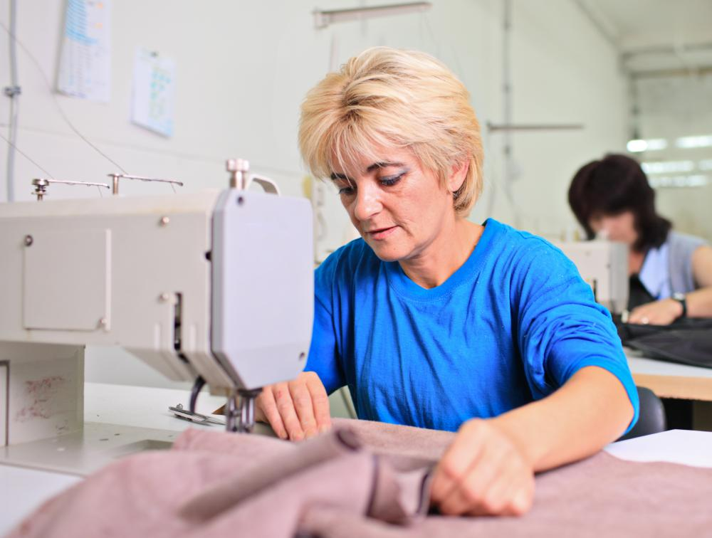 A woman using a sewing machine.