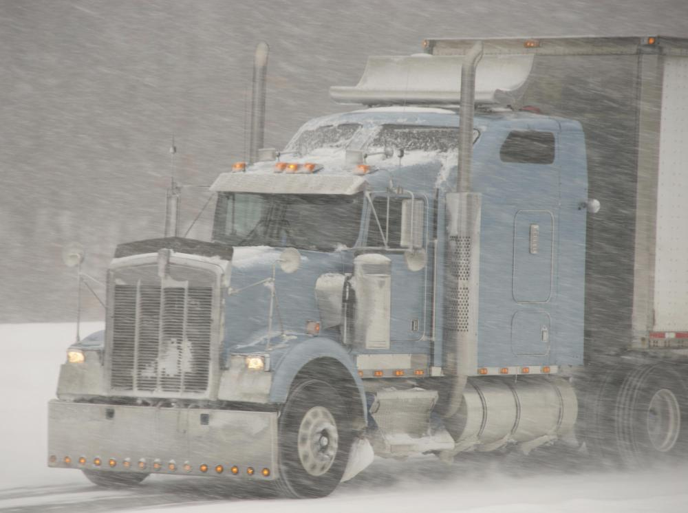 Stopping a tractor trailer can be difficult in inclement weather conditions.