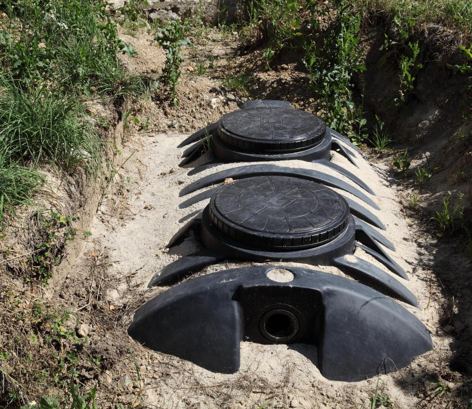 Submersible sewage pumps are located inside a septic tank.