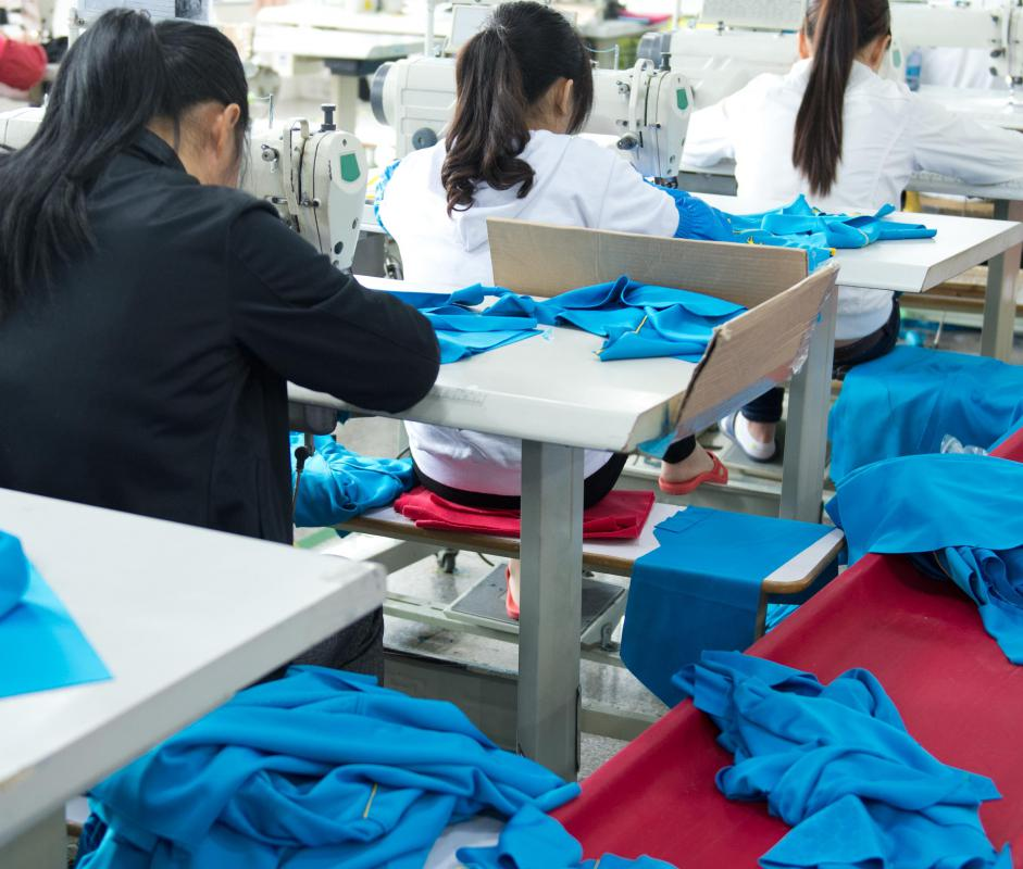 Sweatshop conditions include low pay and long working hours.