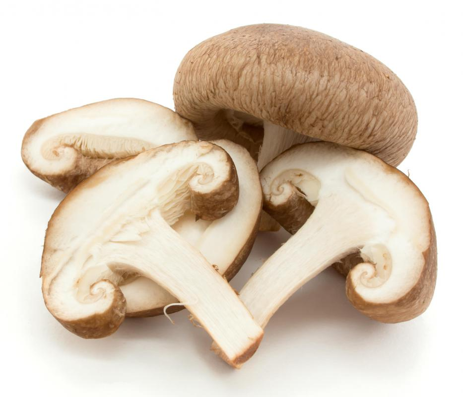 Whole and sliced shiitake mushrooms.