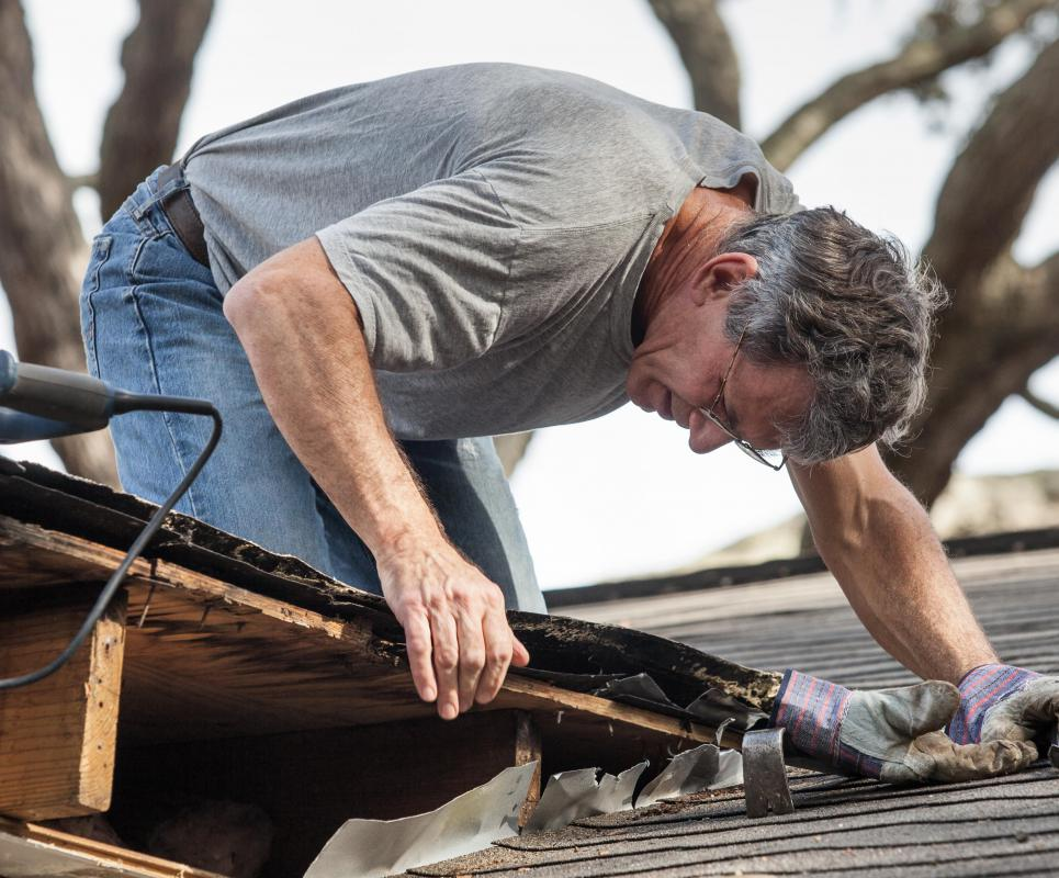 A roof inspector is responsible for examining the roof of a building and completing a report detailing its condition.