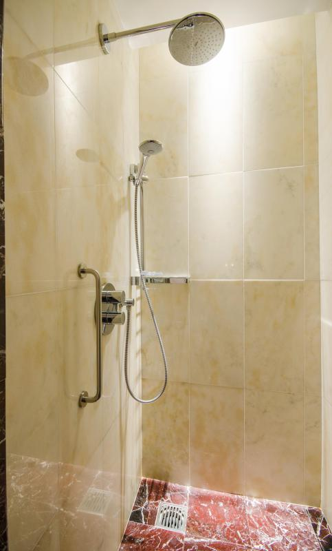 Shower enclosures are typically designed as part of a bathroom's overall aesthetics.