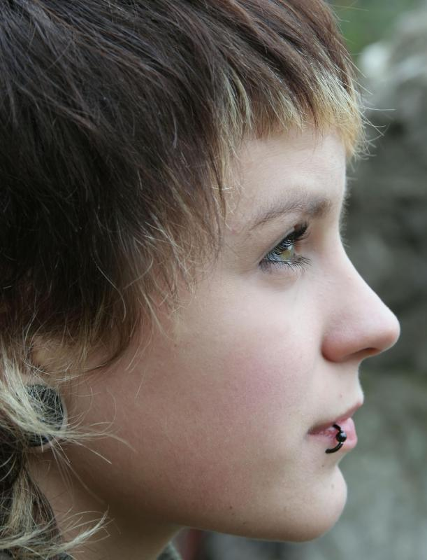 A variety of body piercings including a lip piercing, can contribute to punk style.