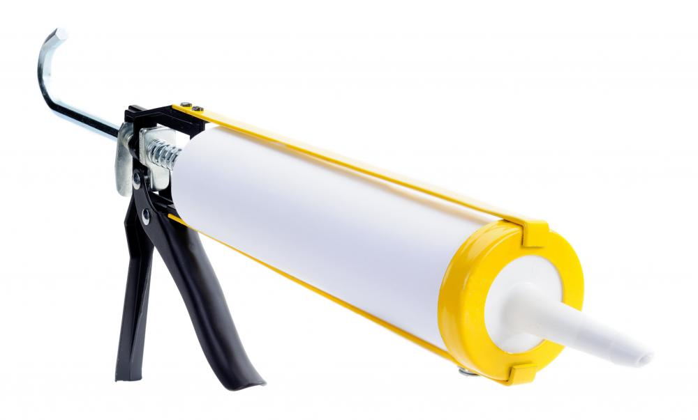 Silicone sealant in a caulk gun, which can be used to repair PVC pipes.