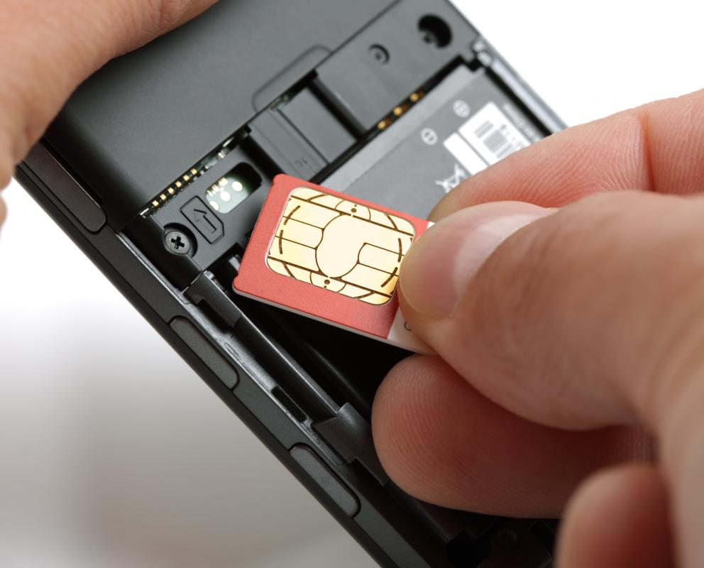 SIM card being placed into a GSM handset.