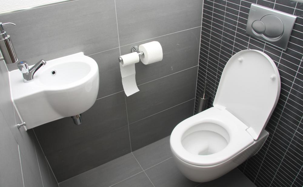 A courtesy flush is most common at a public restroom while others are nearby.