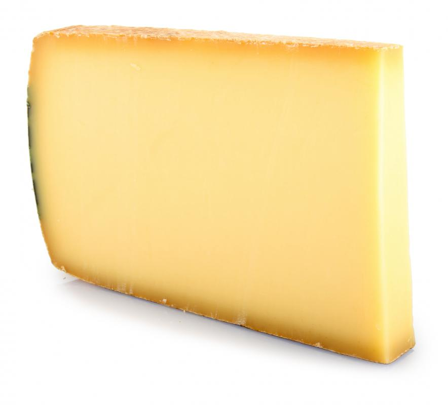 Thick slice of Gruyere cheese, which is often included in potato cheese casserole.