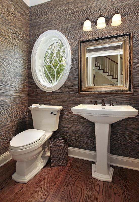New flooring, wallpaper and light fixtures can add beauty to a small bathroom.