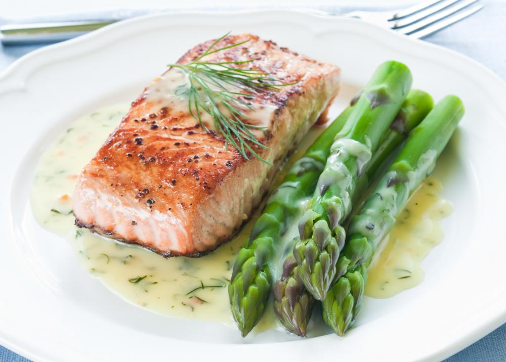 Grilled salmon with a butter sauce is a healthy meal choice.