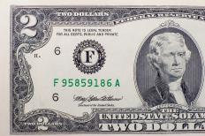 A US $2 banknote. This note is relatively uncommon, so some people might like to collect them.