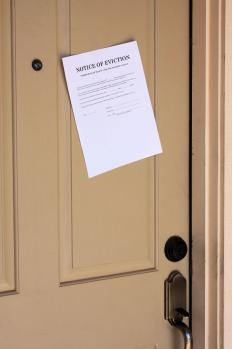 A notice of eviction posted on an apartment door.