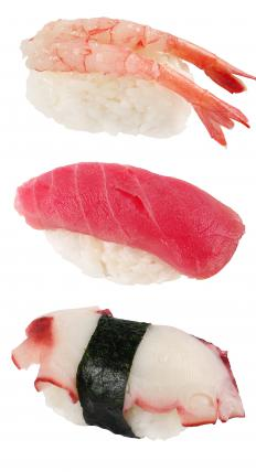 Nigiri sushi assortment with the middle piece made with toro.