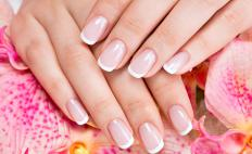 The French manicure consists of a light pink nail bed and a white tip.