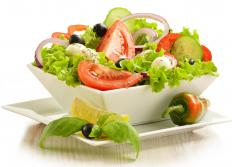 An oil can may be used to dispense dressing on a fresh salad.
