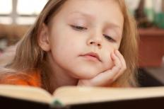 Myopia may cause children to hold books very close to their faces when reading.