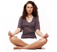 Individuals may learn meditation techniques at a meditation workshop.