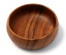 A wooden bowl made on a turning lathe.