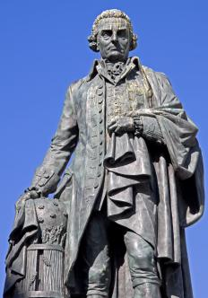 "A monument honoring Adam Smith, who used the term ""invisible hand"" in his book The Wealth of Nations."