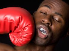 Gloves are mandatory in conventional boxing matches to protect each of the fighters.