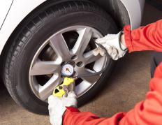 Tire irons are used when putting a new set of tires on an automobile.