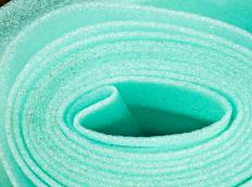 Rolls of polyethylene tape are sticky on one side, allowing it to be easily adhered to flat surfaces.