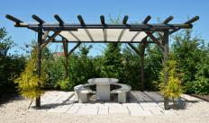 A garden pergola is often used as a cover for outdoor seating.