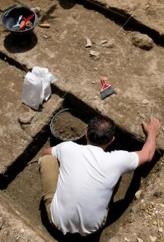 Archaeologists do most of their work in the field as they excavate sites.