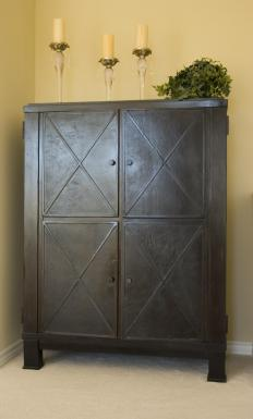 Armoires are typically larger and more detailed than wardrobes.
