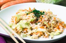 An Asian cabbage salad made with vinegar and oil is a low-carb dining option.