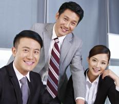 Asian co-workers spend their lives believing that each individual is only part of a team.