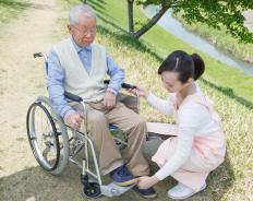 A visiting nurse may take the elderly outside for fresh air and sunshine.